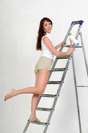 handywoman: The girl is the house painter  Stock Photo