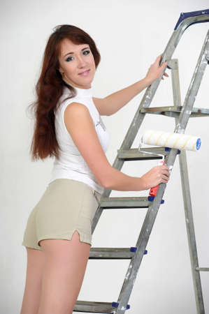 The girl is the house painter  Stock Photo - 12665575
