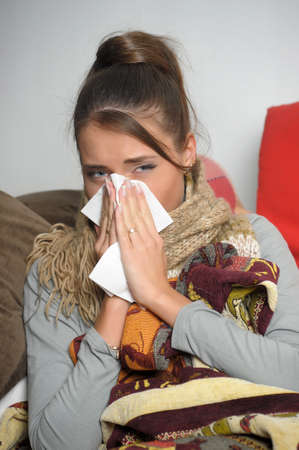 handkerchief: Young woman is ill in bed  She is feeling miserable  Stock Photo