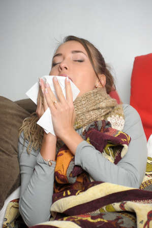 Young woman is ill in bed  She is feeling miserable  Stock Photo - 12588044