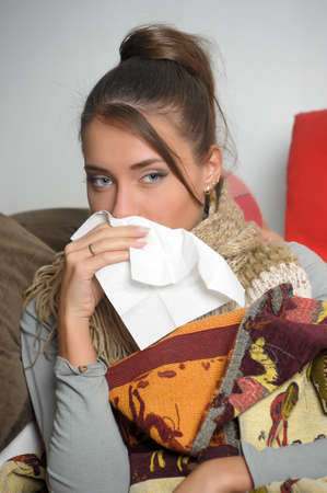 Young woman is ill in bed  She is feeling miserable  Stock Photo