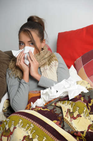 Young woman is ill in bed  She is feeling miserable Stock Photo - 12588078