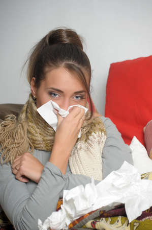 Young woman is ill in bed  She is feeling miserable Stock Photo - 12587778