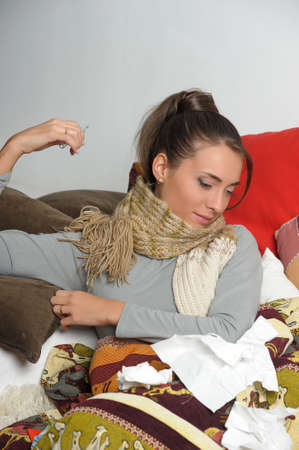 hanky: Young woman is ill in bed  She is feeling miserable  Stock Photo