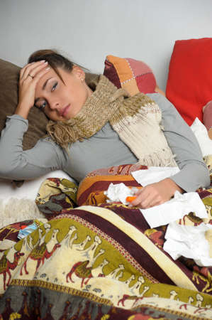Young woman is ill in bed  She is feeling miserable Stock Photo - 12588082
