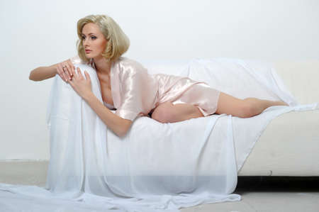 sexy blonde in a negligee Stock Photo - 13931843
