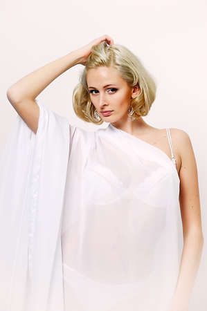 sexy blonde in a negligee Stock Photo - 13931849