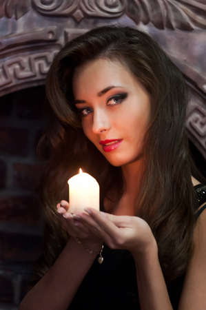 the beautiful brunette with candles Stock Photo - 13280731