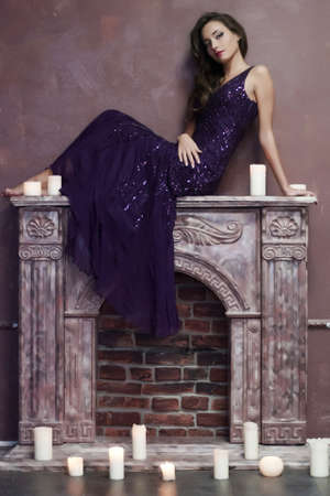 the beautiful brunette with candles photo