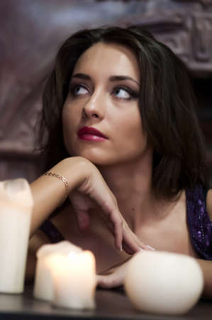 soothsayer: the beautiful brunette with candles