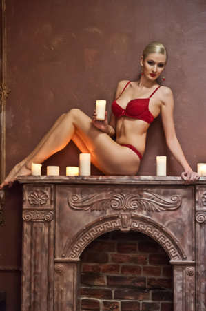Sexy woman with candles Stock Photo - 13503011