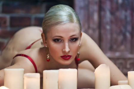 Sexy woman with candles Stock Photo - 13502992