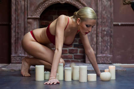 Sexy woman with candles photo