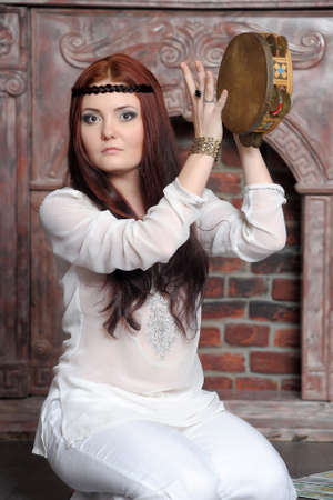 Attractive girl with music instrument photo