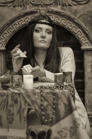 psychics: woman with cards and candles