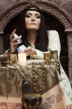 astrologer: woman with cards and candles