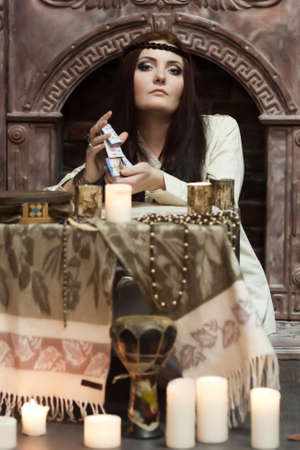woman with cards and candles photo