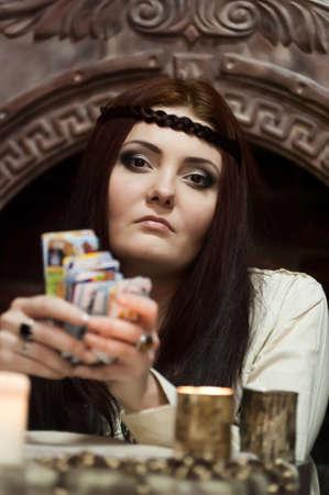 cartomancy: woman with tarot cards