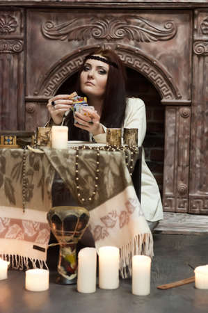magus: woman with tarot cards