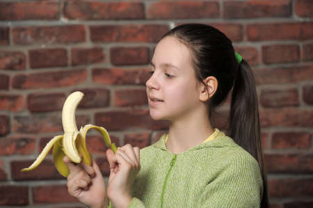 The girl the teenager with banana photo