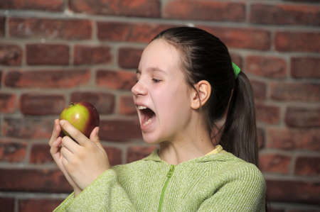 Teen eating green apple  photo