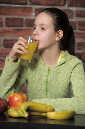 girl with juice and fruit  Stock Photo - 14494758