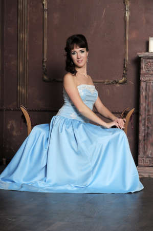 The young woman in a graceful ball dress  photo