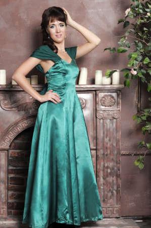 Elegant beautiful woman in fashion dress posing indoors Stock Photo - 13931153