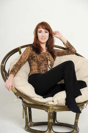 young woman in a chair  photo