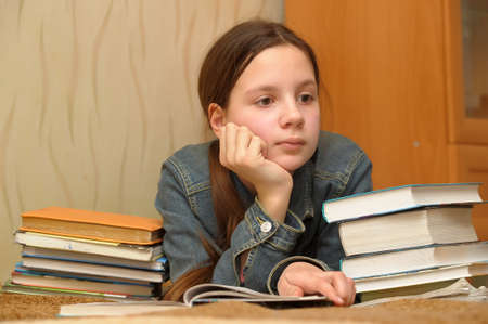 The girl the teenager is upset by the big homework Stock Photo - 13006604