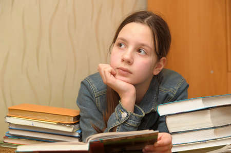 The girl the teenager is upset by the big homework Stock Photo - 12986703