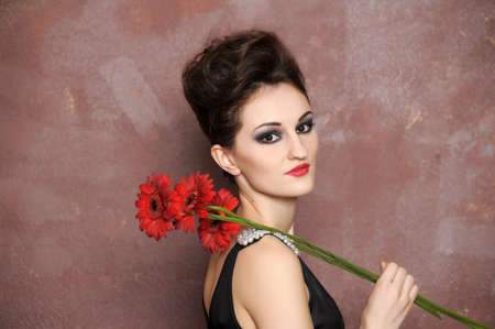 penumbra: Attractive woman with red flowers