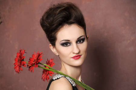 Attractive woman with flowers  photo