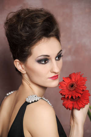 Attractive woman with red flowers  photo