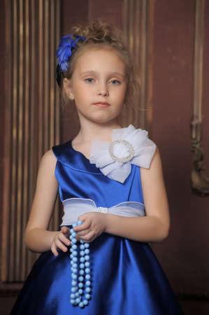 Little Girl Looks Like A Small Princess In Beautiful Blue Dress Stock Photo - 15283071