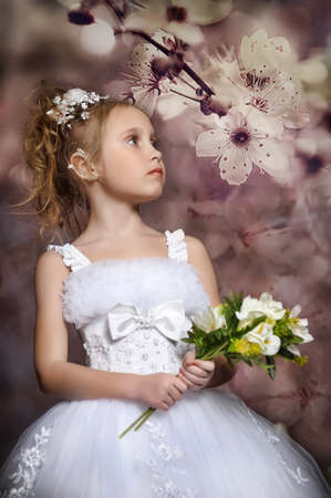 flowergirl: Beautiful little girl in white dress Stock Photo
