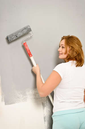 The girl is the house painter  Stock Photo - 13039242