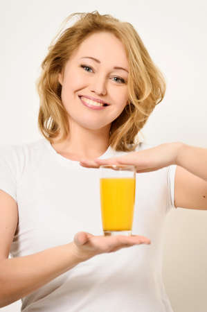 Girl with a glass of fresh orange juice  Stock Photo - 13164384