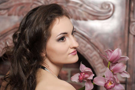 young woman with orchids photo