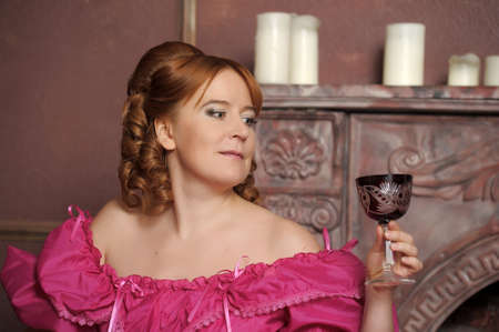 portrait of the woman in a medieval dress with a glass in hands Stock Photo - 13153643