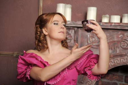 portrait of the woman in a medieval dress with a glass in hands Stock Photo - 13153641