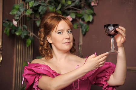 portrait of the woman in a medieval dress with a glass in hands Stock Photo - 13153651