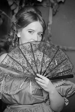 The romantic lady of the Victorian era with a fan photo