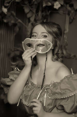 vintage  woman with a mask photo