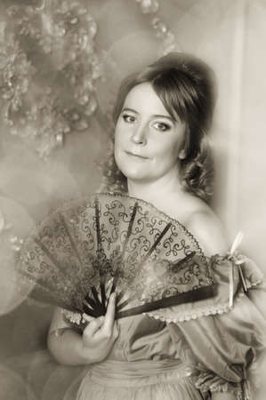 The romantic lady of the Victorian era with a fan Stock Photo - 13152861