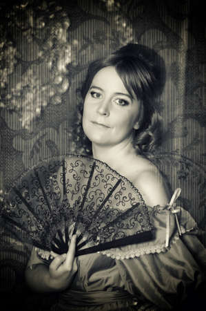 The romantic lady of the Victorian era with a fan Stock Photo - 13152870