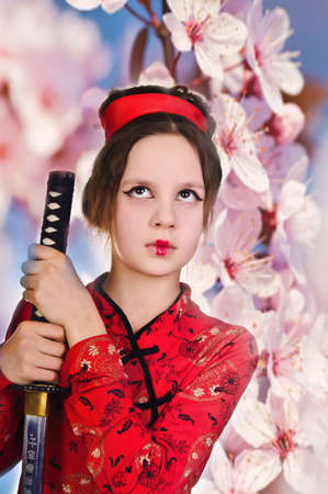 A girl handling a long samurai sword  photo