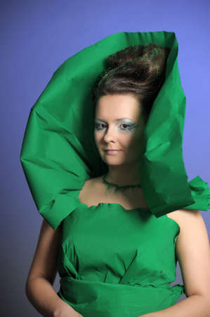 Portrait of attractive woman in green dress photo