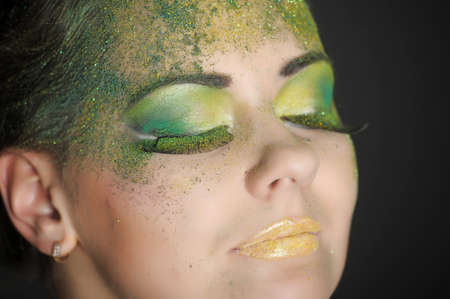 theatrical: Young lady with bright make up closeup portrait