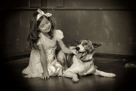 Vintage portrait of a little girl with dog Stock Photo - 13146492